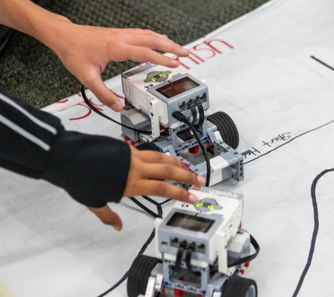 Students using programmable robots
