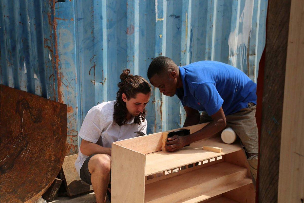 Enactus Team member working with Ghana community member